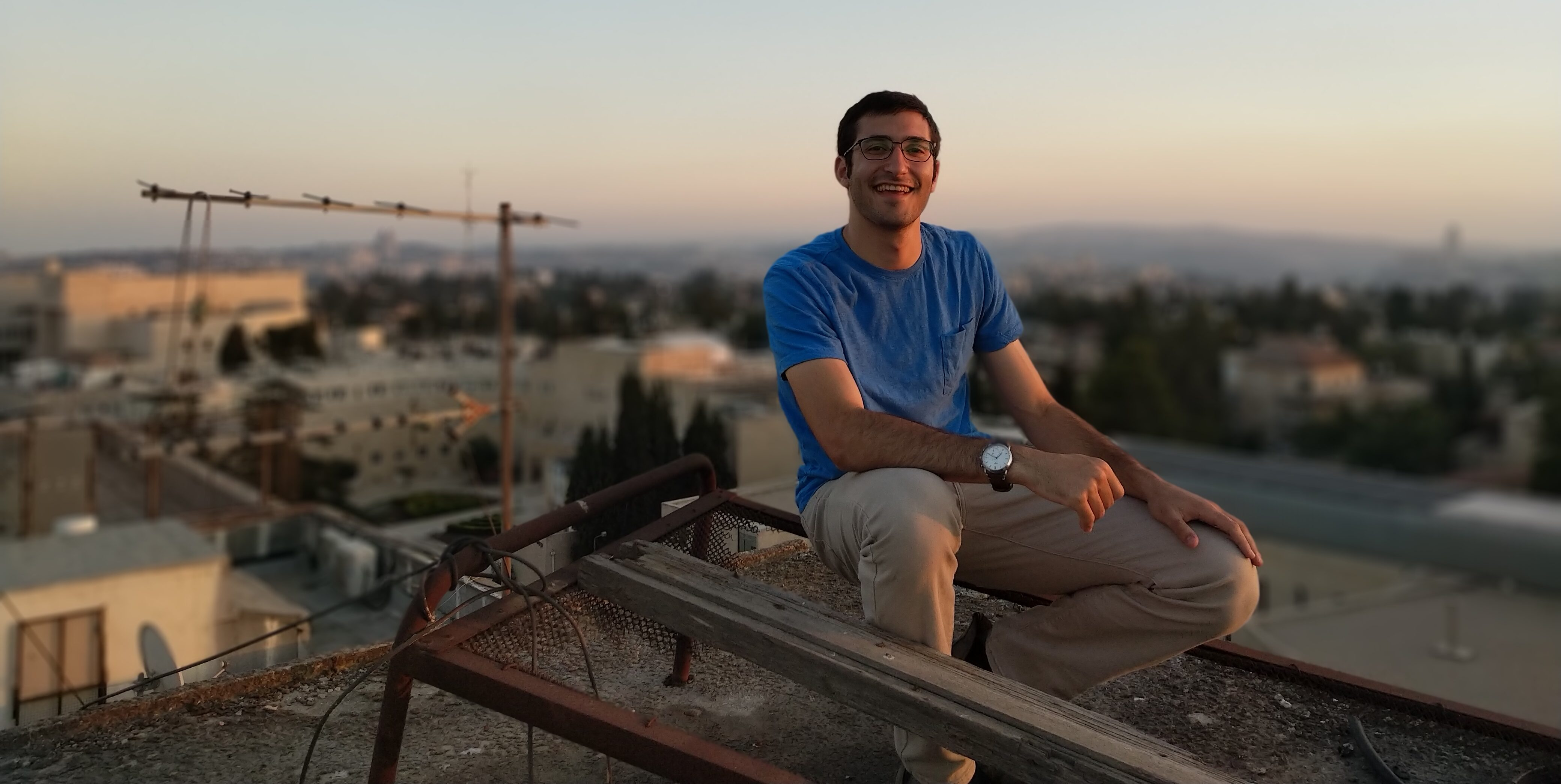 A Picture of Shaun sitting on an abandoned roof in Jerusalem